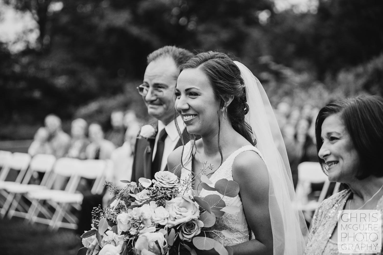 Bride smiles at wedding