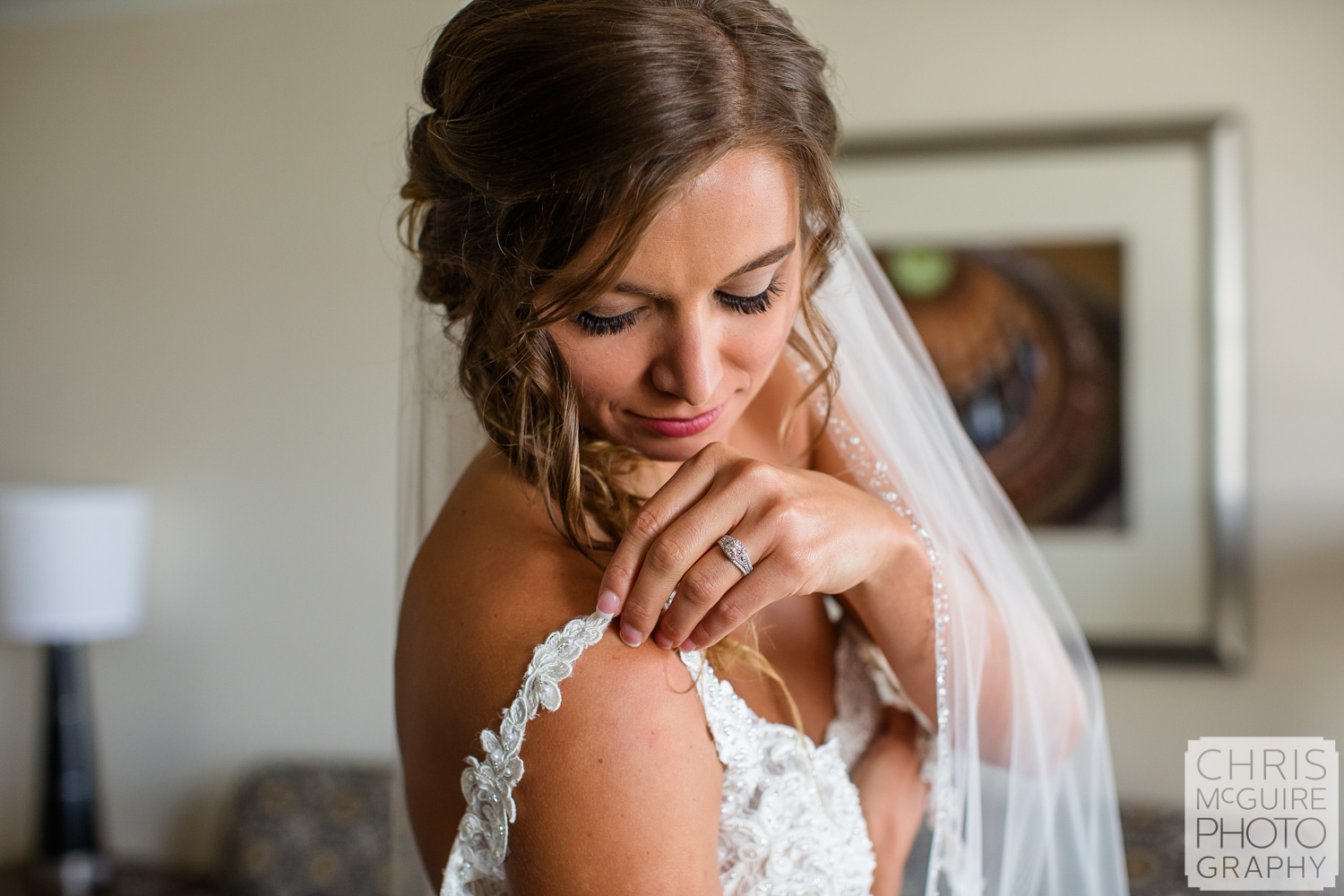 Bride puts on wedding dress at Abe Lincoln Hotel in Springfield Illinois