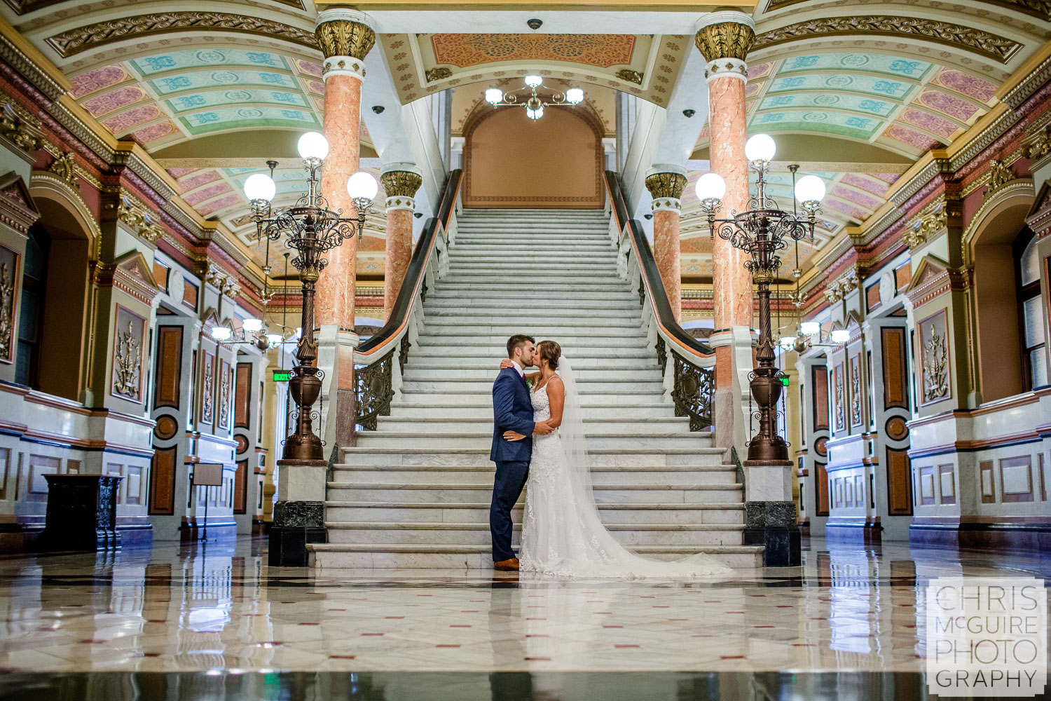 Bride and groom kiss at Illinois State Capitol in Springfield