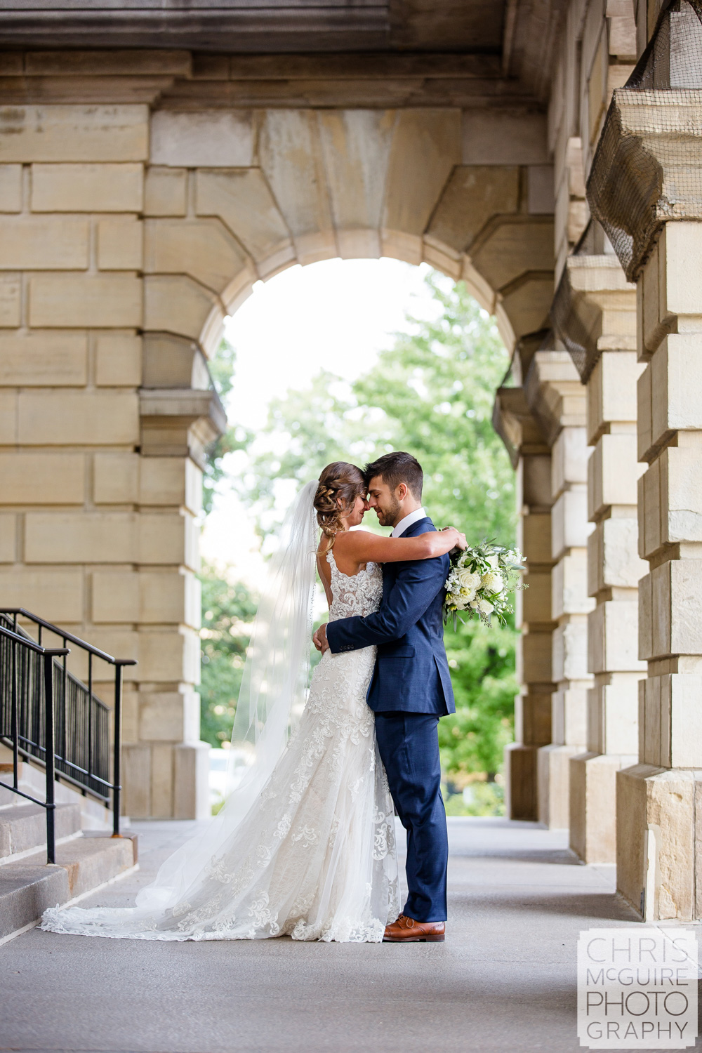 Bride and groom in arches at Illinois State Capitol in Springfield