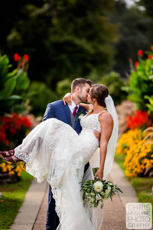 Bride and Groom kiss at Washington Park in Springfield Illinois