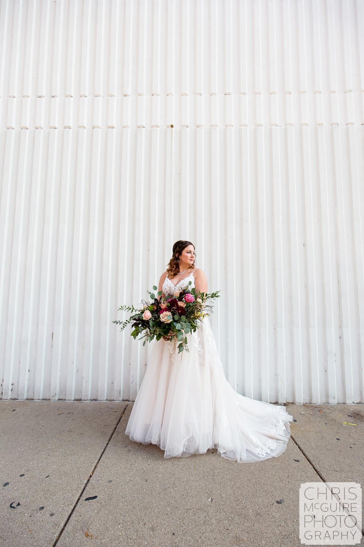 Bride with white wall in Peoria IL