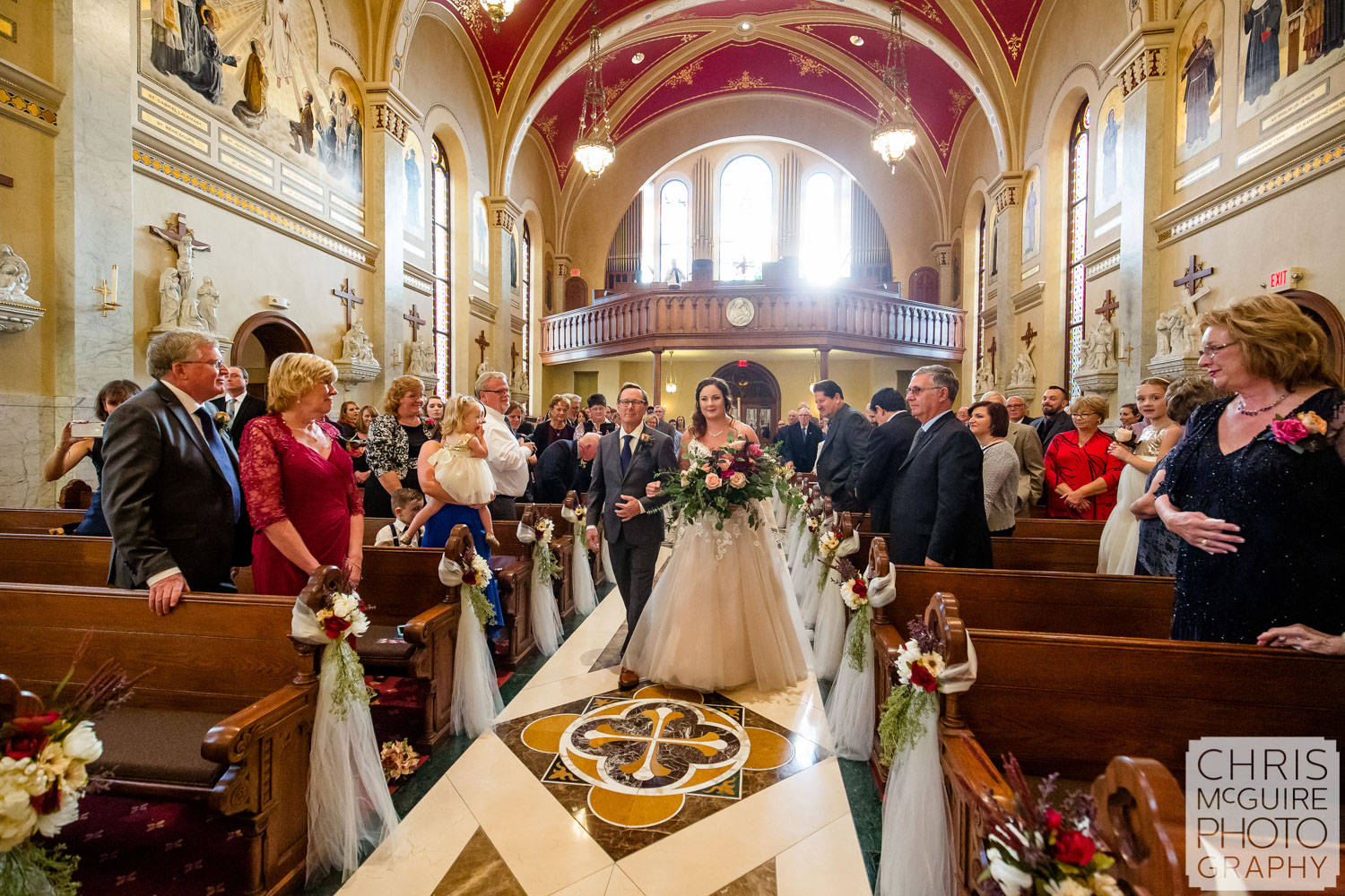 Bride and father walk down aisle at Peoria Sacred Heart