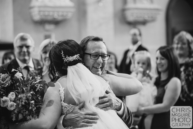 Bride hugs father at Peoria IL wedding