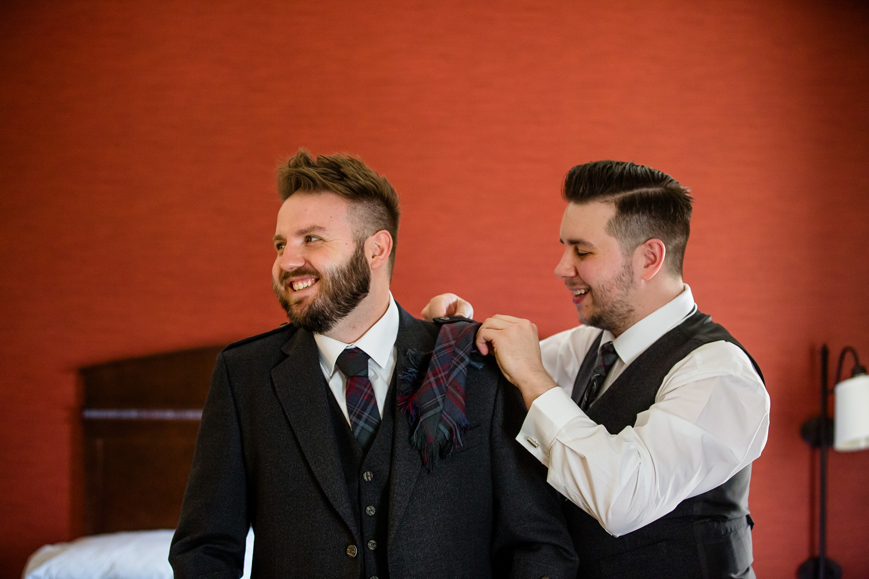 Scottish groom getting dressed