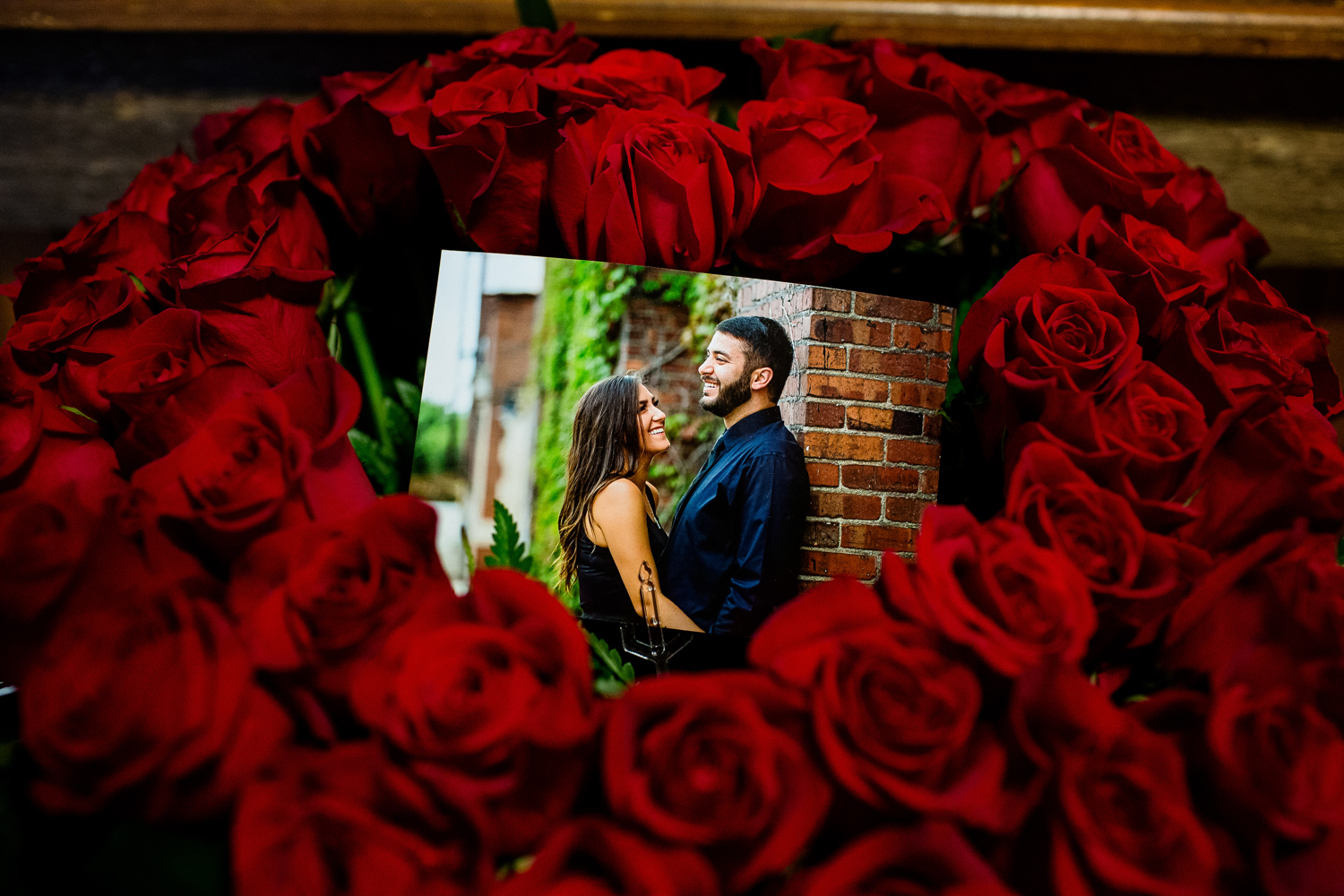 Engagement picture in heart of roses