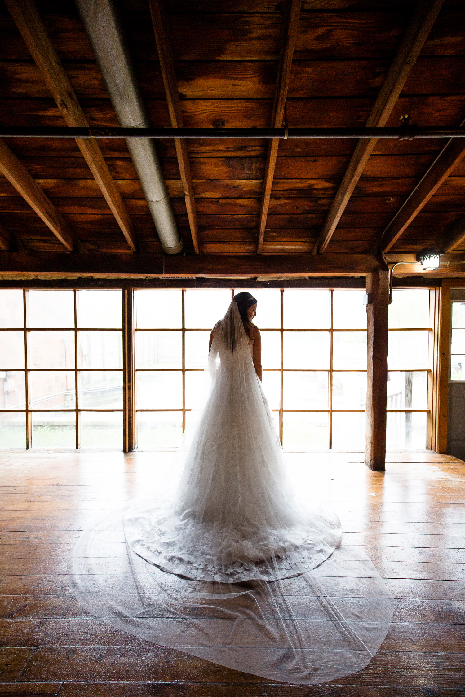 Bride in front of wall of windows