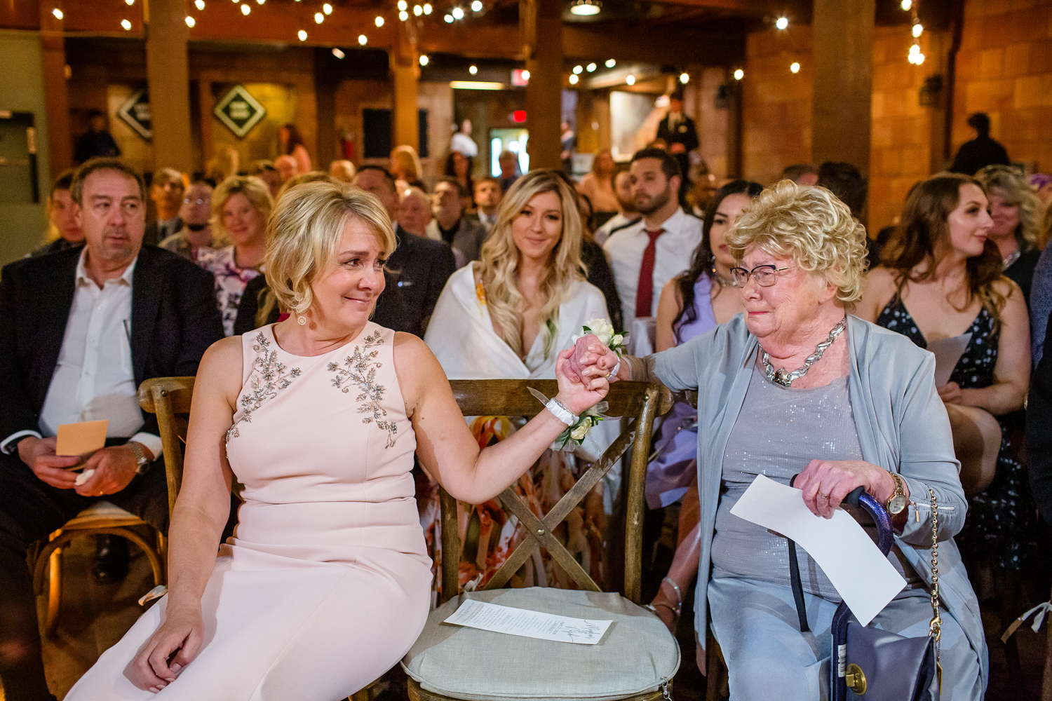 Mother and grandmother of bride have moment before wedding