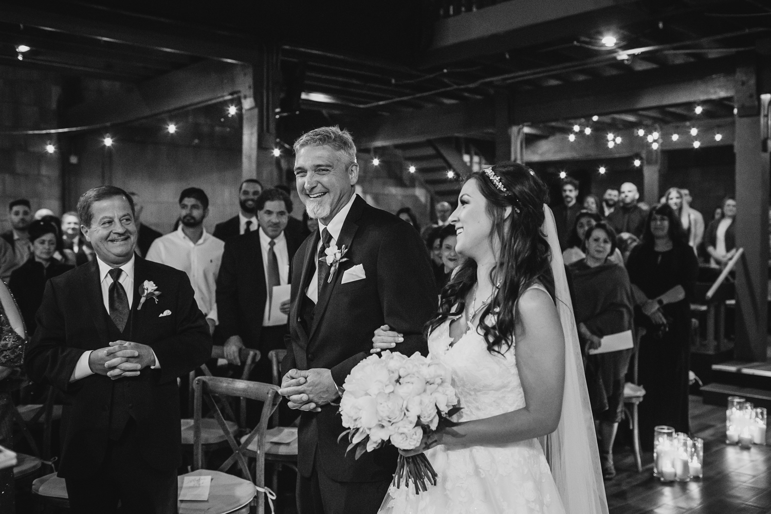 Bride and father laugh at wedding