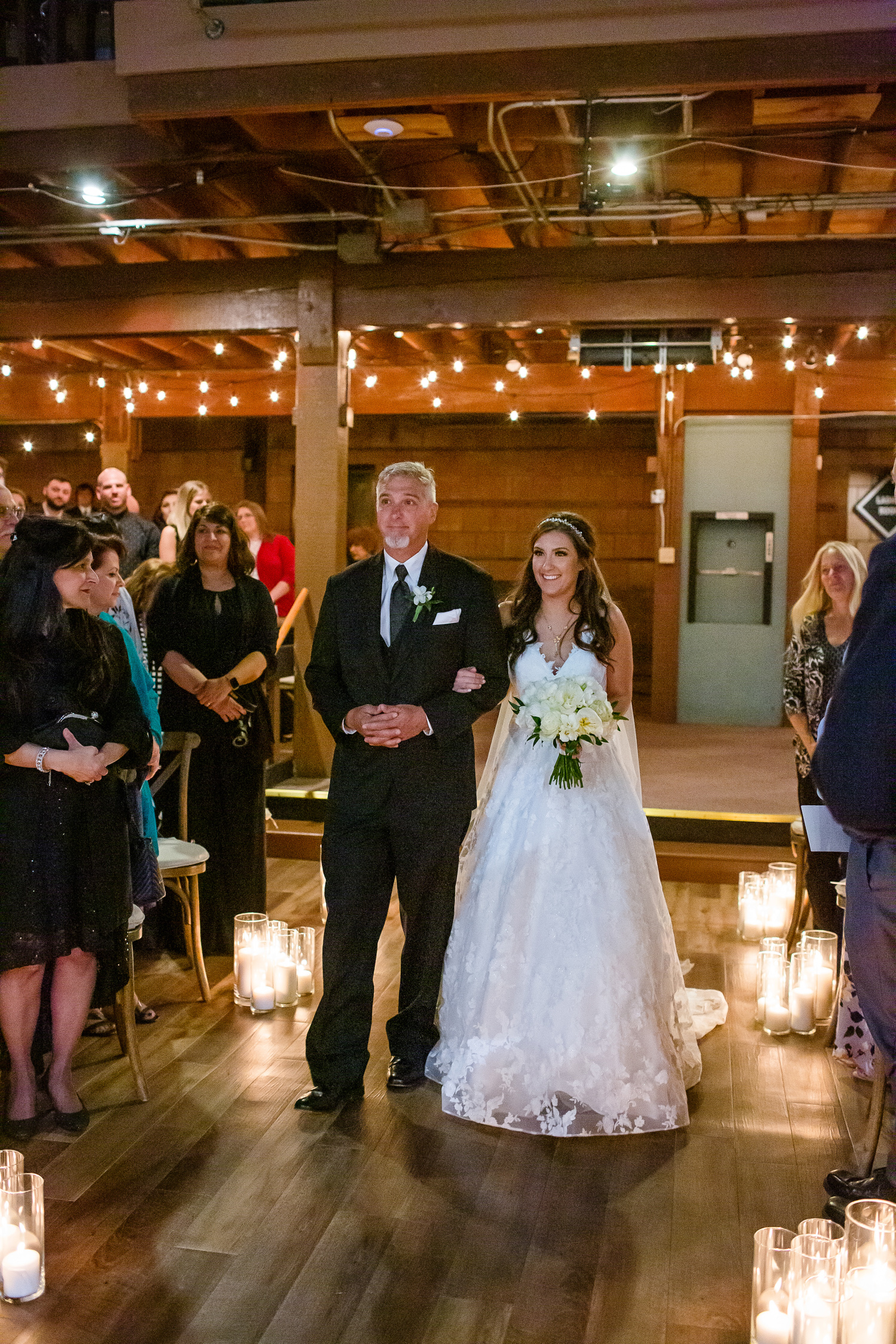 Bride and father walk down the aisle at Second Chance Church in Peoria IL