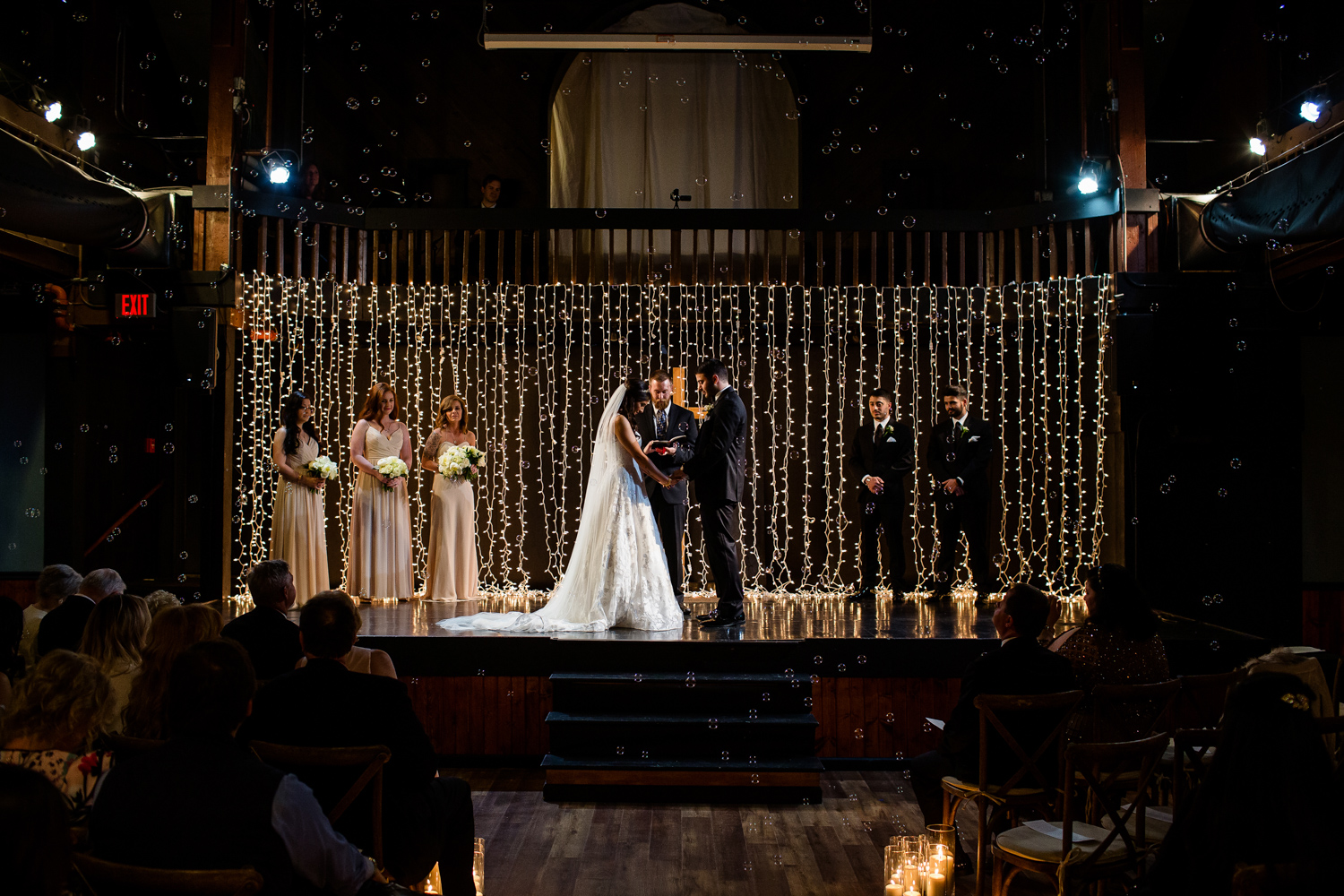 Wedding ceremony with bubbles and string lights