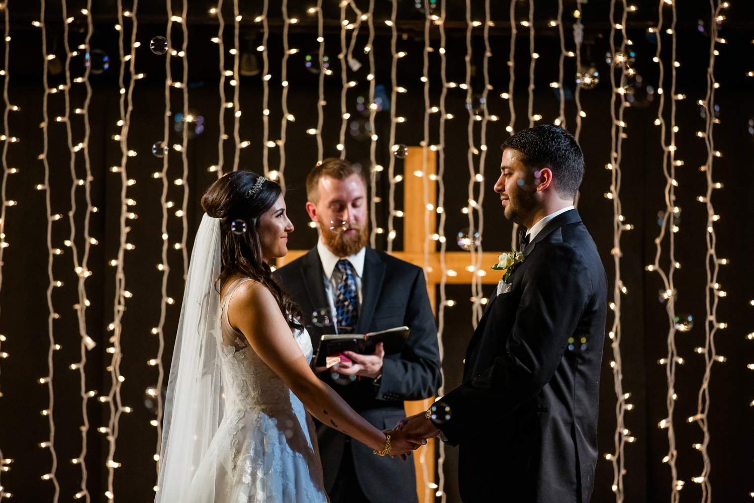 Peoria Wedding ceremony with bubbles and string lights