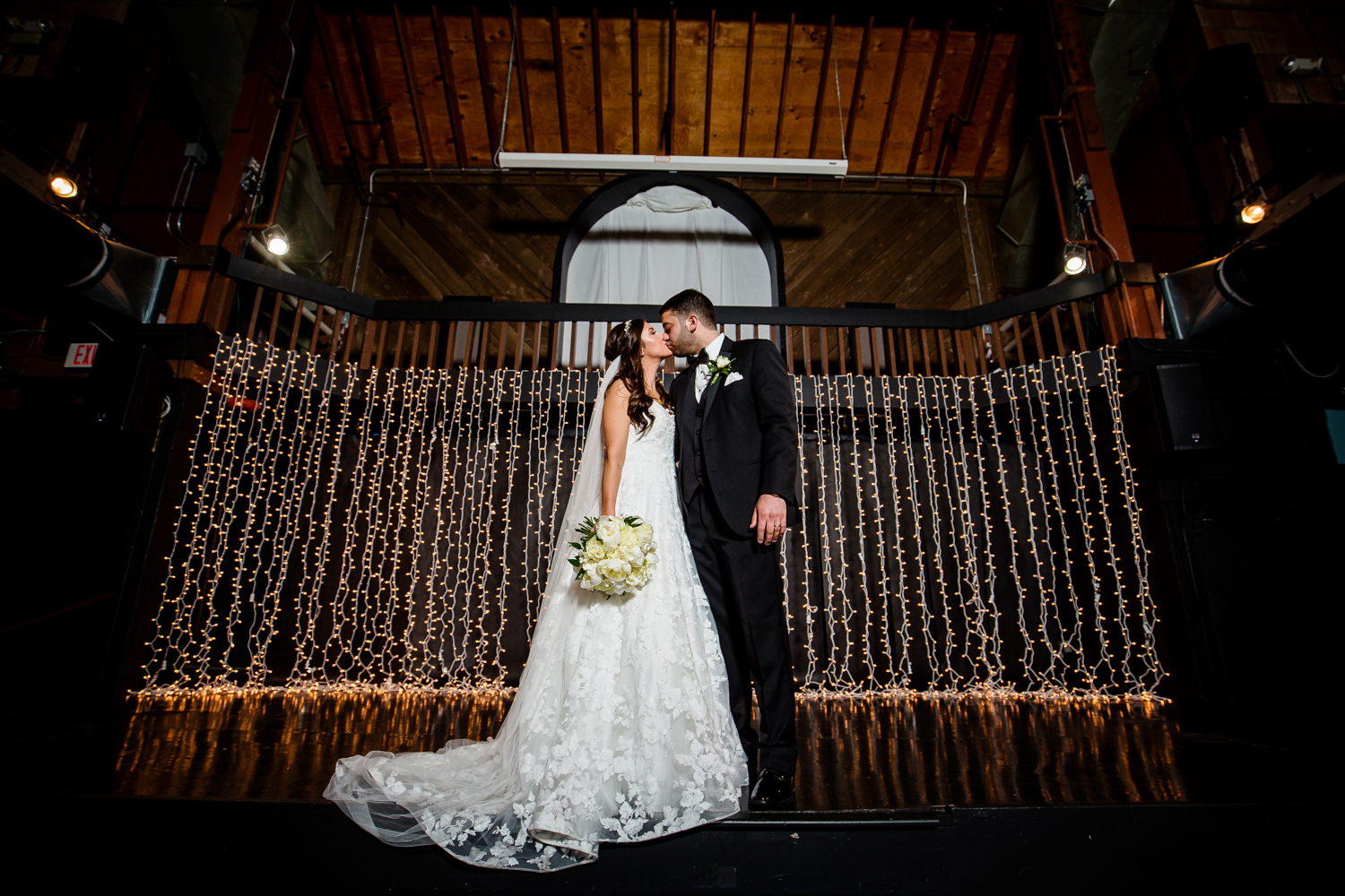 Bride and Groom kiss at Second Chance Church in Peoria IL