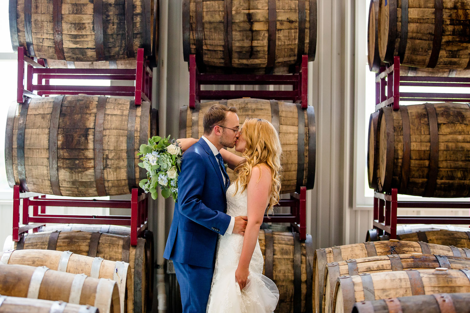 Destihl Brewery Wedding Bride and Groom with Barrels