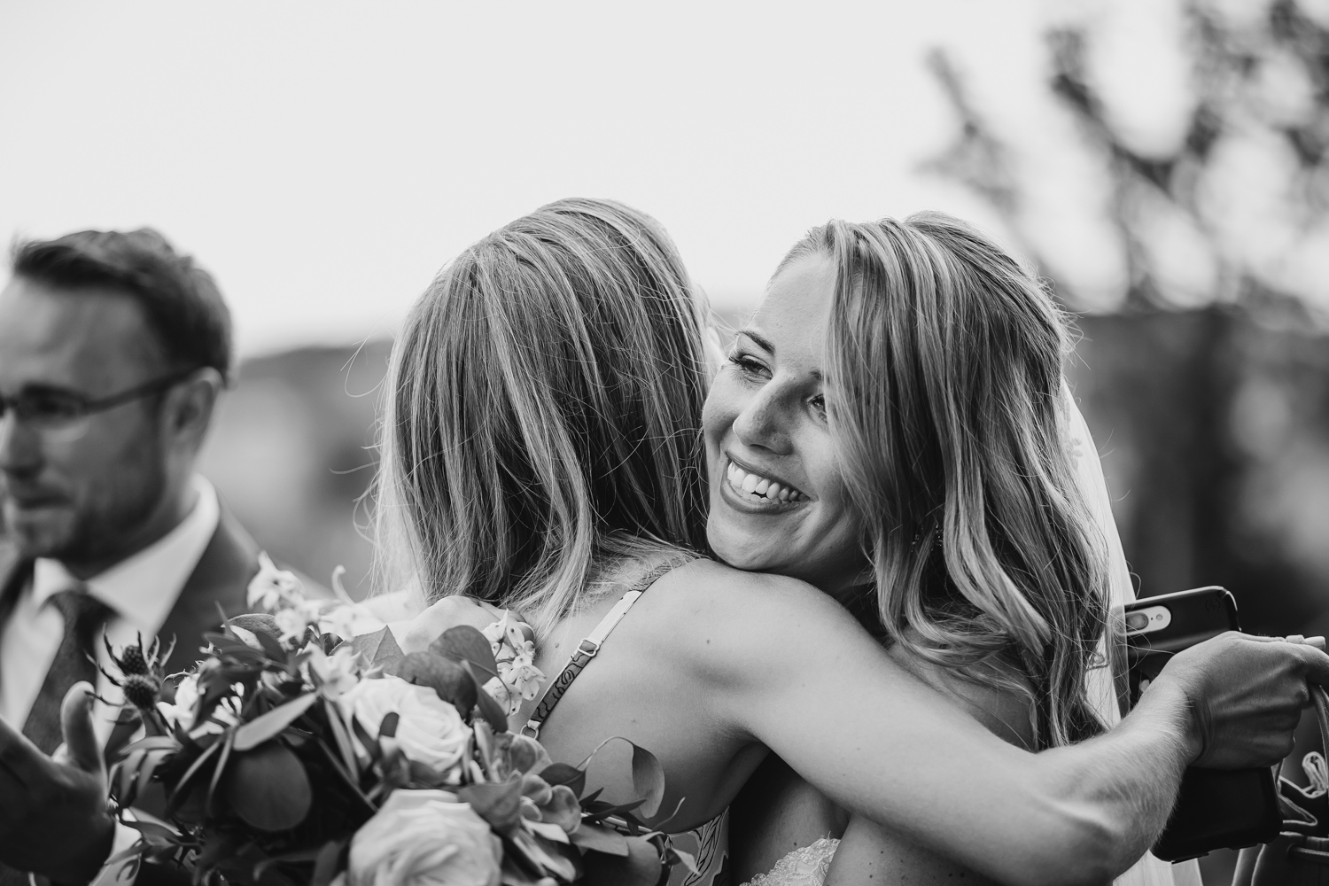 Bride hugs friend