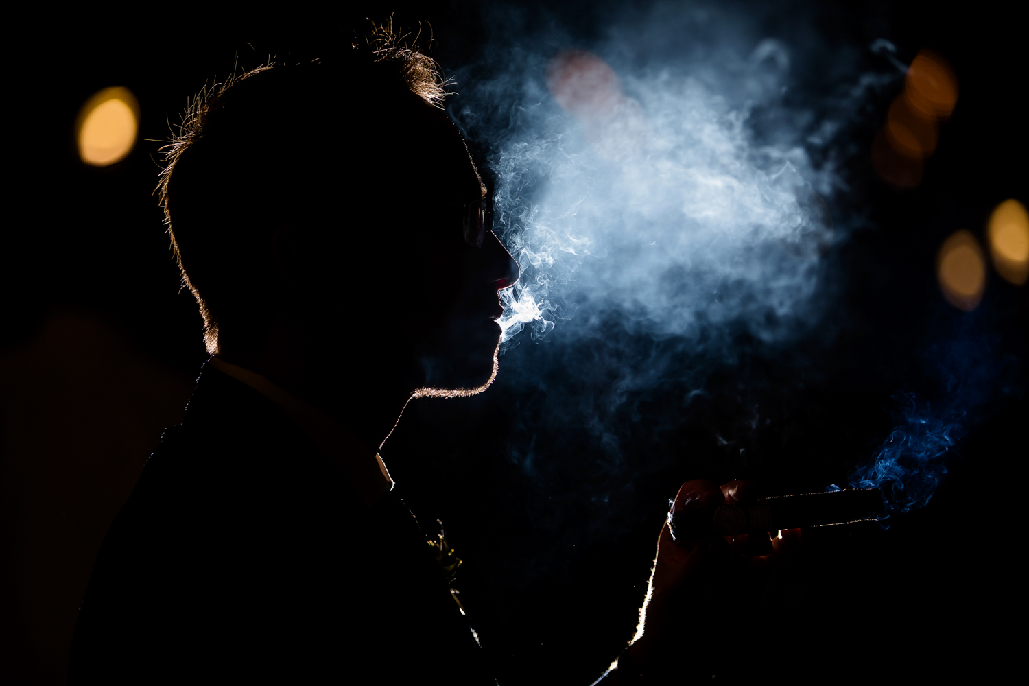 Groom smoking cigar silhouette