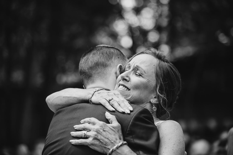 Wedding hug mom groom