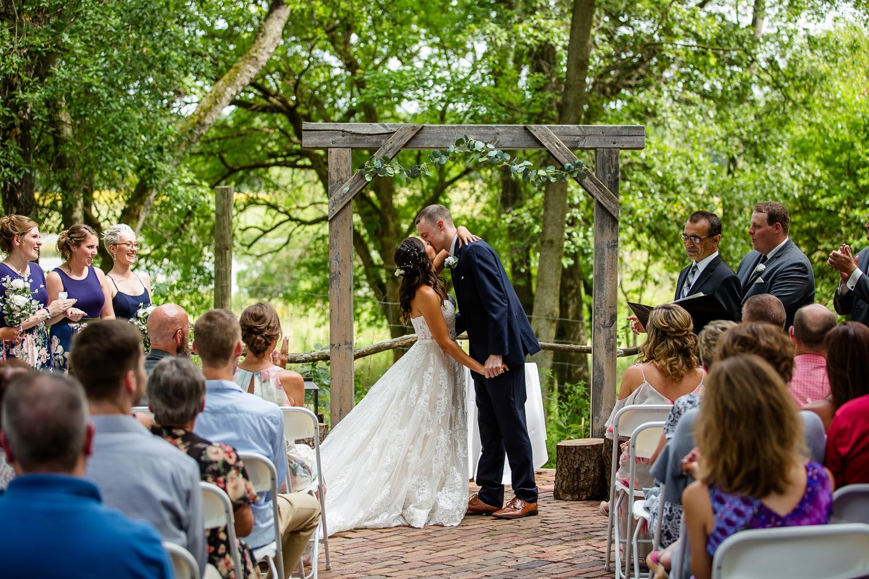 Wildlife Prairie Park Wedding First Kiss at Vista Bricks