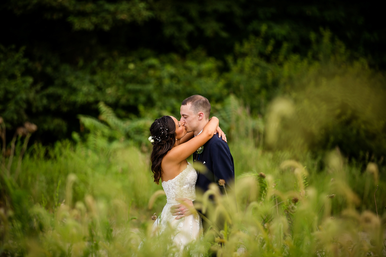 Midwest Bride Groom kiss in tall grass