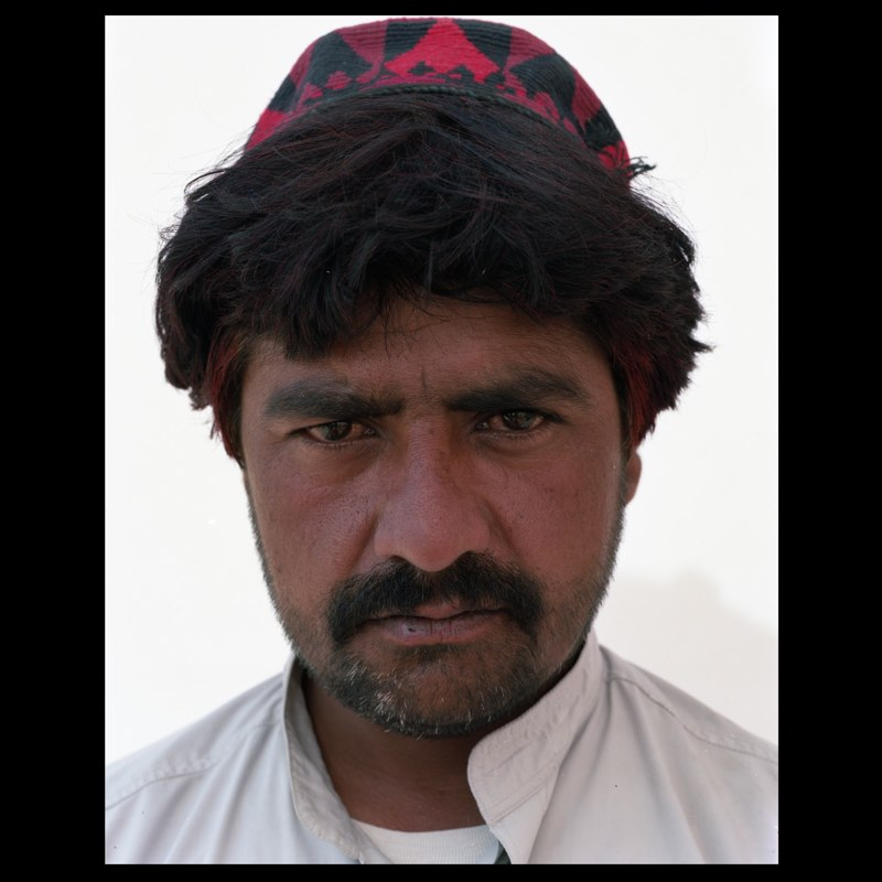 An Afghan villager waiting to sign up for the USAID Cash for Work Program.