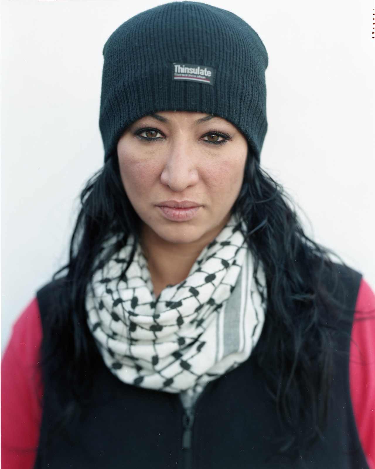 "Neda Kadri from Dearborn, Michigan. Neda was an activist for the Syrian revolution, and has been working in Lesbos as a volunteer, helping on the shore and pulling in boats, since December 2015. She calls the crossing ""the curse of the bittersweet,"" because as refugees are traveling to Greece in search of asylum and safety, many are dying along the way."