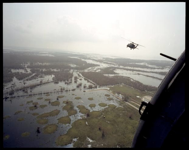 Helicopters with 82nd Airborne fly over flooded area in Cameron Parish Louisiana surveying the damage, September 27, 2005.