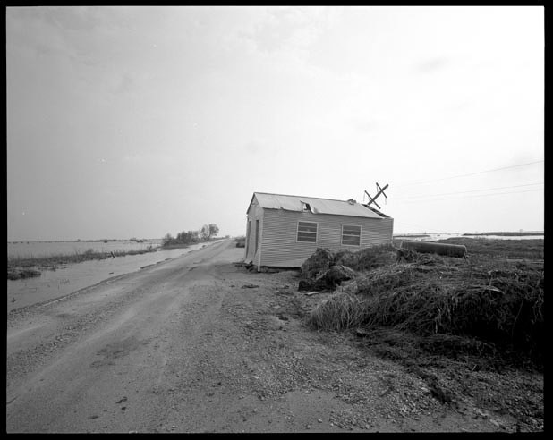 House pushed across a road by storm surge in Cameron Parish Louisiana, September 27, 2005.