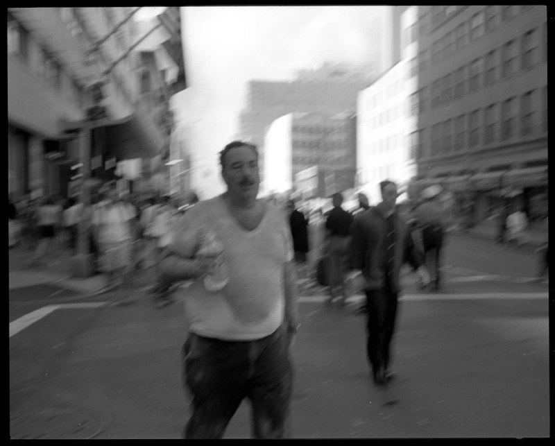 Man walks from the collapse of the World Trade Towers n lower Manhattan, September 11, 2001.