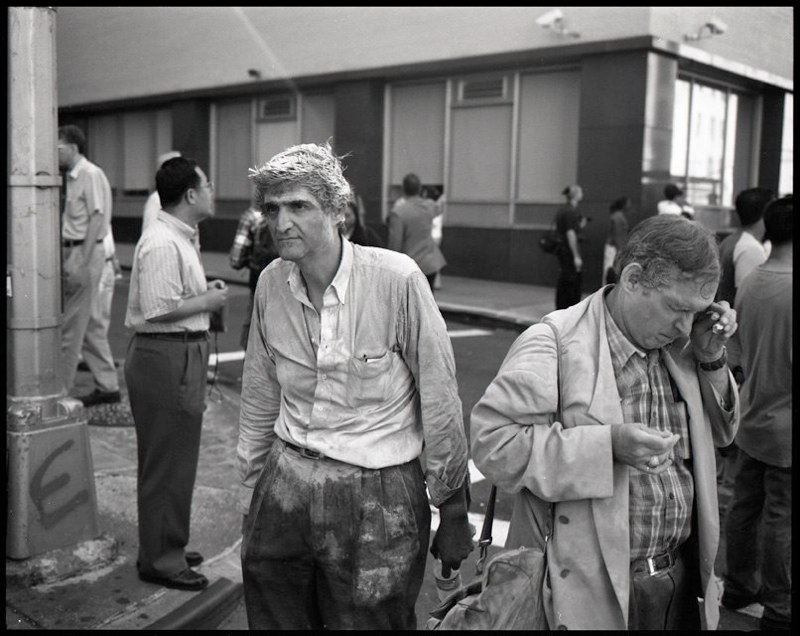 Two men walking away from the collapse of the World Trade Center towers in lower Manhattan, September 11, 2001.
