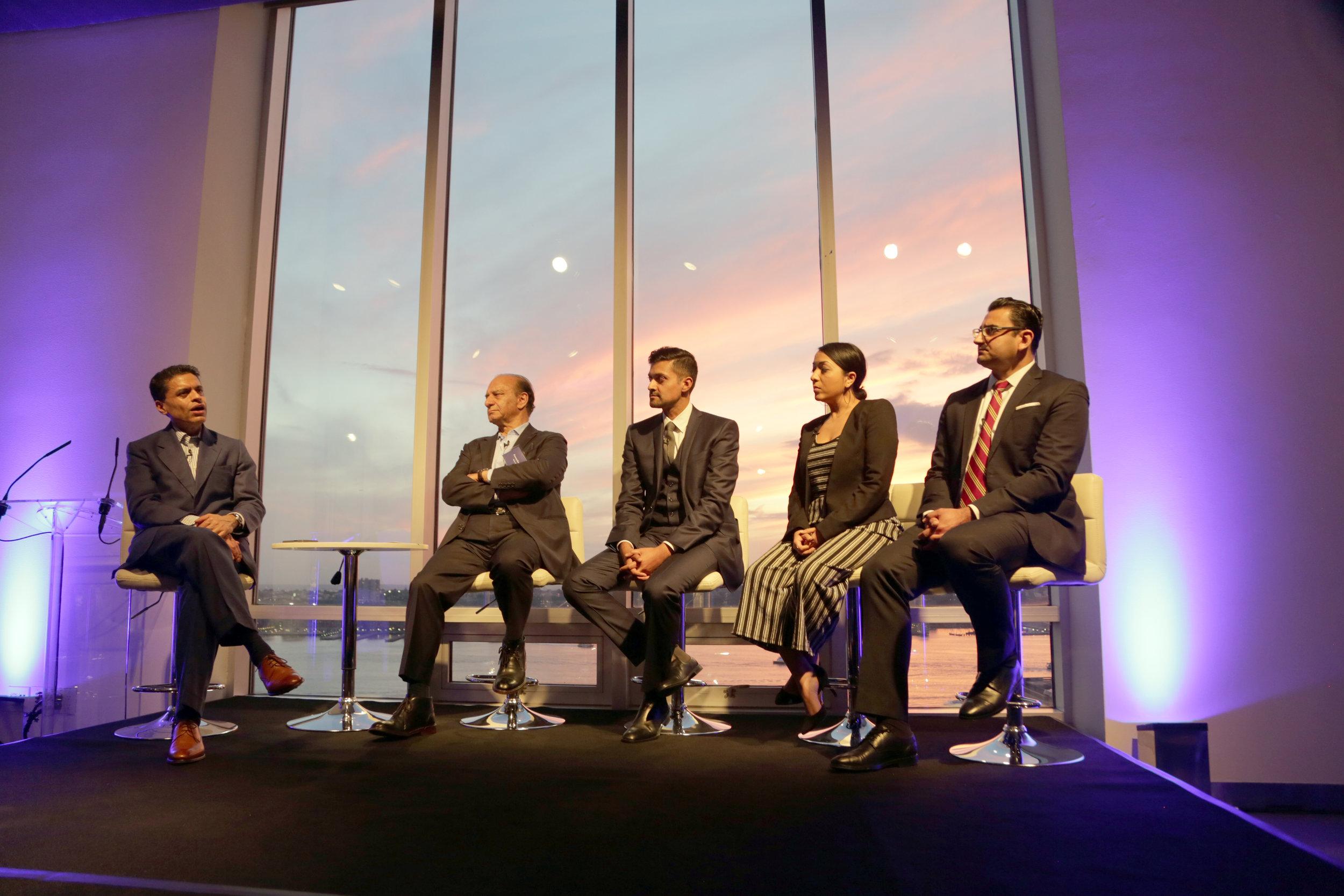 CNN's Fareed Zakaria moderates a panel at a McKinsey event, Summer 2018.