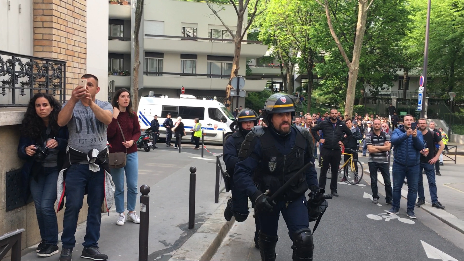 Marie-Hélène films violent May Day protests in Paris - May Day protests in Paris turn into riots as anti-government demonstrators clash with the police. French police fired tear gas into the crowds while protestors threw rocks and broke windows.