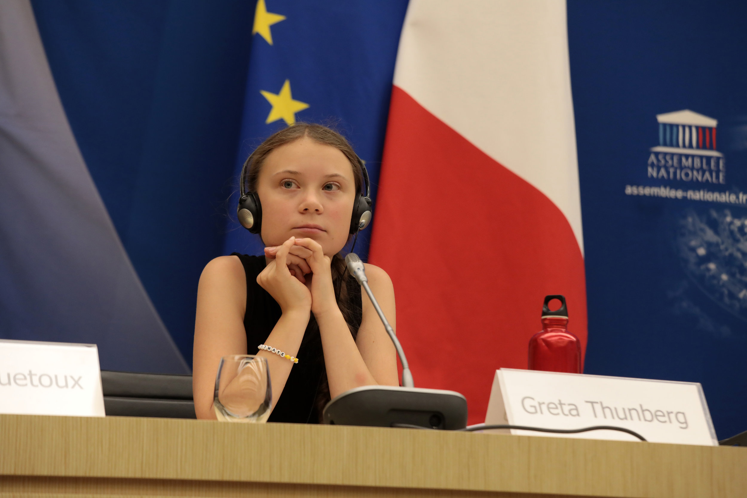 Micah photographs Greta Thunberg for Getty Images, photo used in RollingStone - Micah's photographs of Greta Thunberg addressing the National Assembly in Paris on July 23 2019 are featured on Getty Images and used in RollingStone, GQ, and Huffington Post France. Her message was that countries and companies had to do more about the climate emergency.