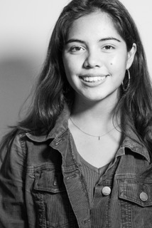 """Xiye Bastida - Xiye Bastida is a teenage climate activist based in New York City and one of the lead organizers of the Fridays For Future youth climate strike movement. For the first climate strike in March, 2019, she mobilized 600 students from her school and has taken a citywide leadership role in organizing climate strikes and speaking out about climate justice issues in rallies and town halls. Xiye was born and raised in Mexico as part of the Otomi-Toltec indigenous peoples. She sits on the administration committee of the Peoples Climate Movement, where she brings the voice of youth to existing grassroots and climate organizations. Xiye launched a youth activism training program to expand the climate justice movement and is a member of Sunrise Movement and Extinction Rebellion. In 2018, she was invited to the 9th United Nations World Urban Forum to speak about indigenous cosmology. She received the """"Spirit of the UN"""" award in 2018."""