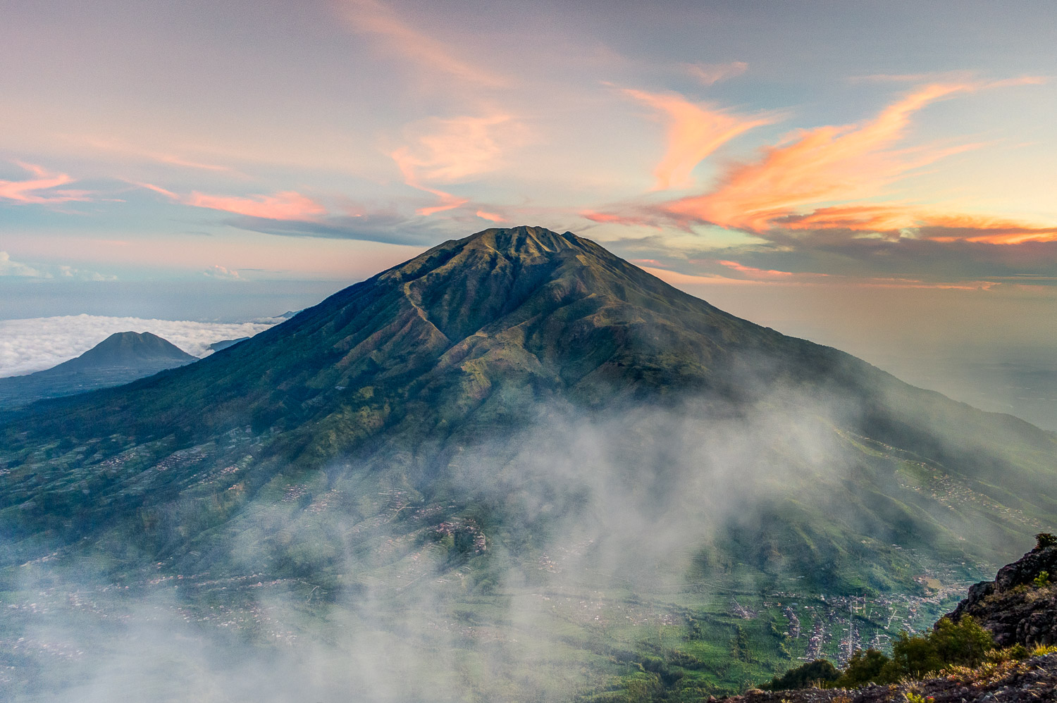 Mount Merbabu at sunrise; the starting point Selo can be seen on the bottom right