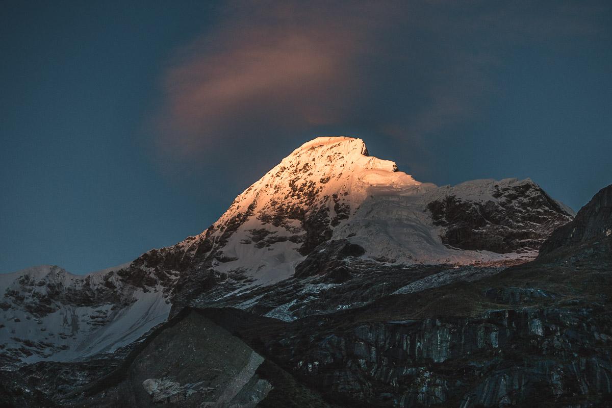 Alpenglow on Artesonraju – clouds immediately start to form around the summit.