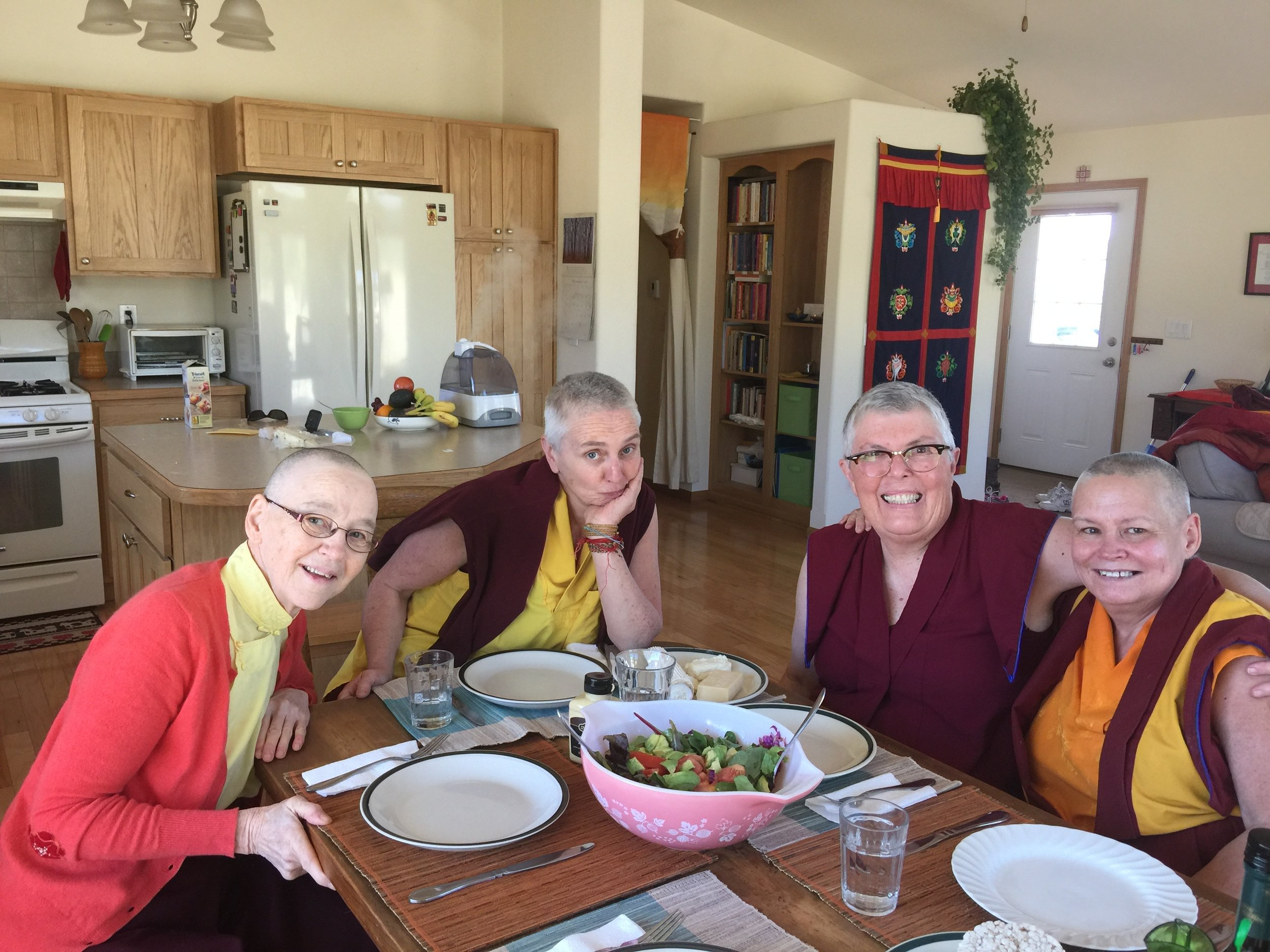 """Monastic sisters enjoying each other's company at the Pema Chöling lunch table. L to R: Ven. Tsering Lhamo, Ven. Thubten Saldon, Ani Jampa Sangmo, and Ani Tsultrim."""""""