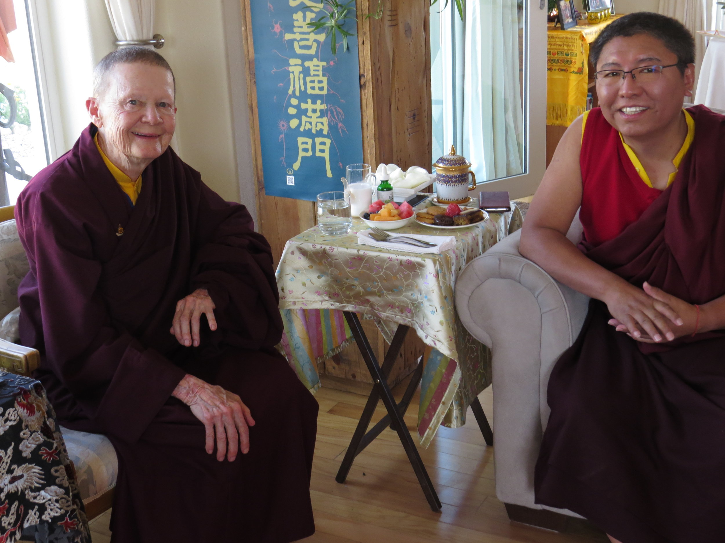 Ven. Pema Chödrön and Tsoknyi Rinpoche have a warm and lively conversation as guests of honor for an afternoon tea with the local and visiting monastics at Pema Chöling.