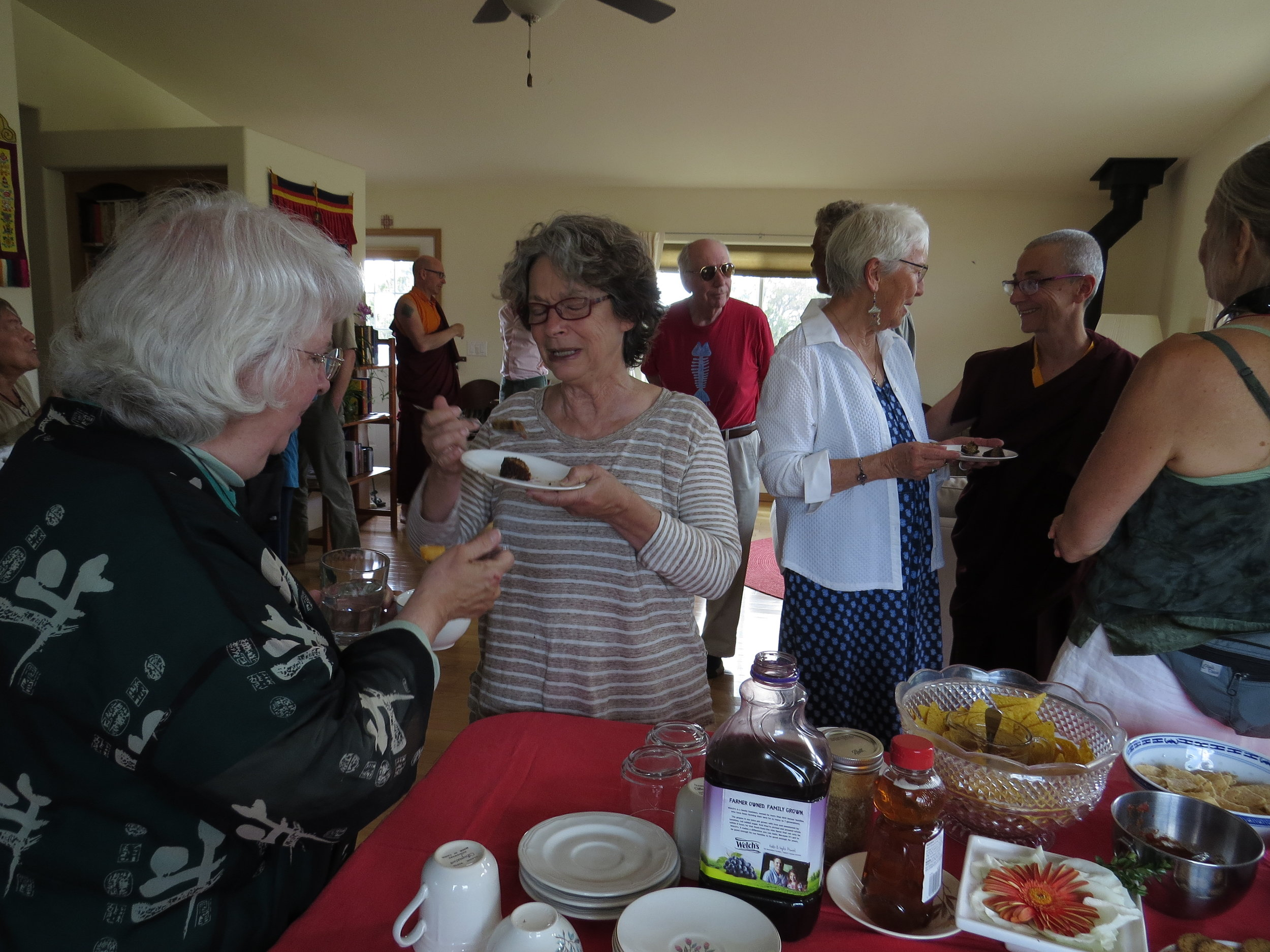 Visitors to the Pema Chöling Open House enjoy refreshments while getting to know the resident and local monastics.