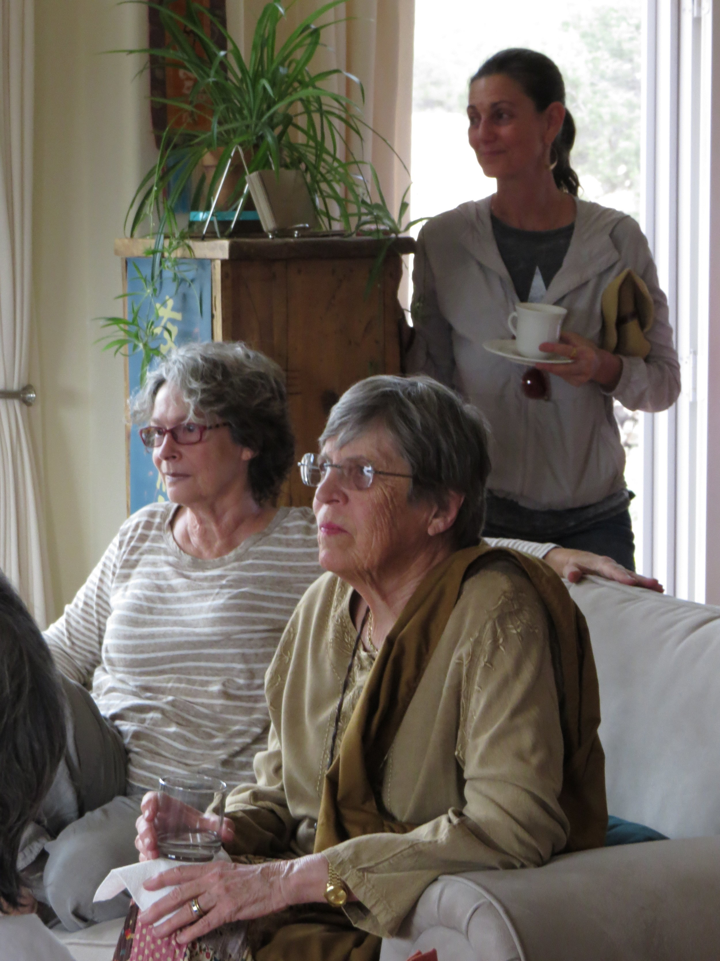 During one of the presentations, Elizabeth Mattis-Namgyel, Pema Chöling's Education Advisor, looks on, along with Barbara Green and M.L. Mackie.
