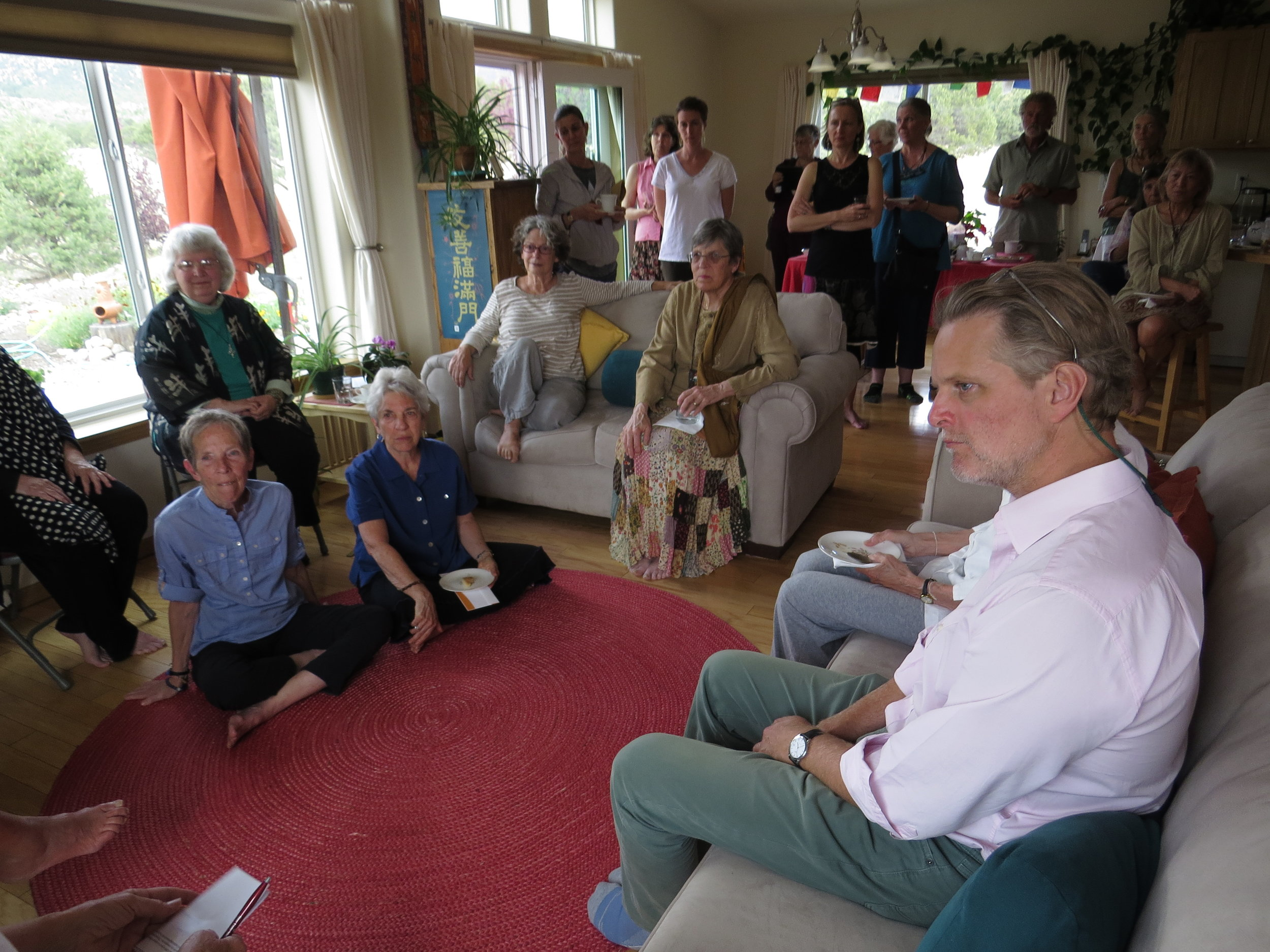 Attendees listen to Ven. Thubten Chödrön's presentation about Pema Chöling's history and activities. In the lower right is Owsley Brown, whose foundation provides major annual support for Pema Chöling.
