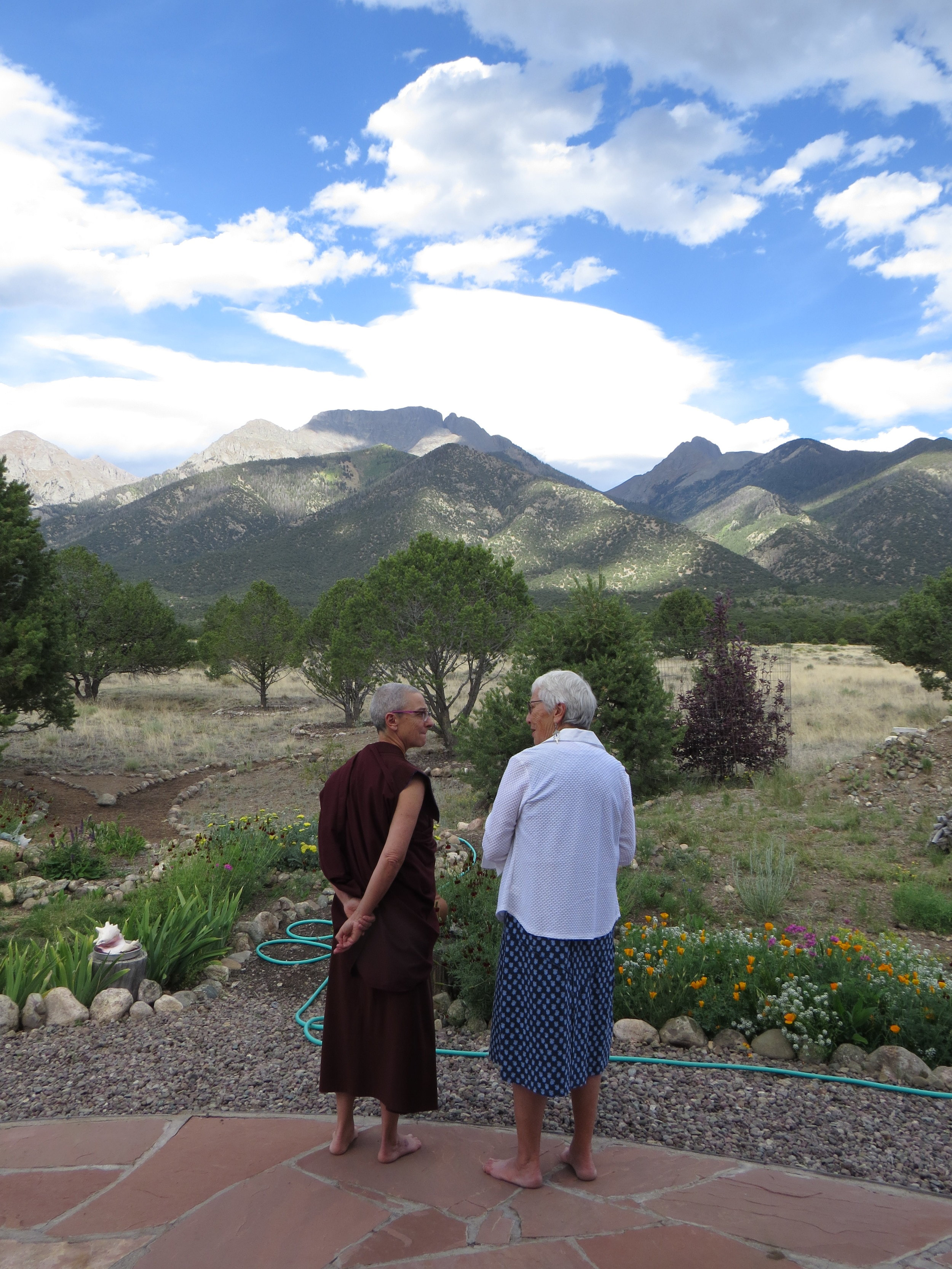 During the Open House, Ven. Thubten and Jane Harris enjoy a quiet moment together amidst Crestone's breathtaking scenery.