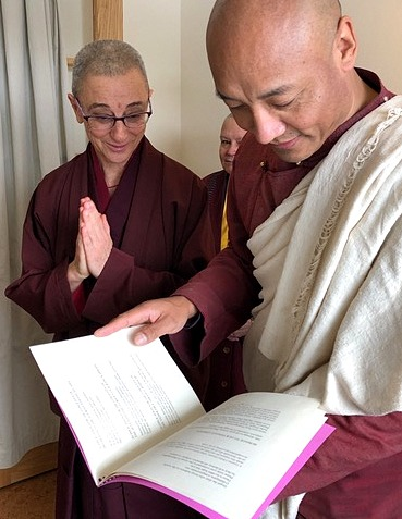 Ven. Thubten Saldon shows Anam Thubten Pema Chöling's newly assembled and printed daily prayer book.