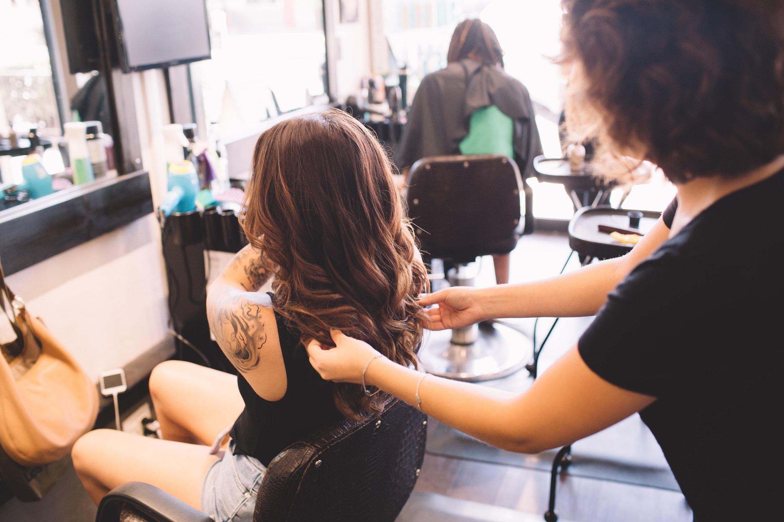 girl-with-long-brown-hair-at-salon