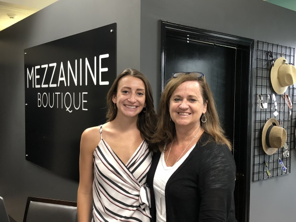 Kim with her daughter, Lindsey, who helps run Mezzanine Boutique.