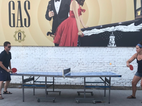 Two players face off during a recent ping pong league match at Armored Gardens.