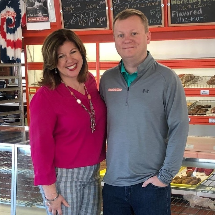 Scott and Cris inside Donuts & More in Davenport