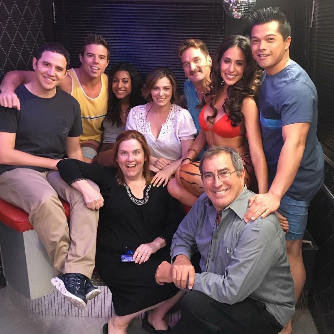 CAST OF CRAZY-EX GIRLFRIEND POSING WITH DIRECTOR KENNY ORTEGA