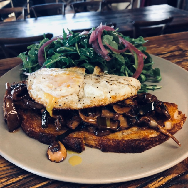 Sauteed wild mushrooms, garlic, leek, port cream sauce, fried egg, country bread, arugula, pickled red onion salad.