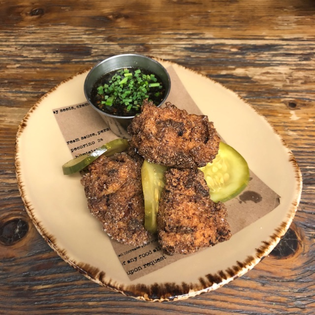 Fried chicken, bread and butter pickles, maple pink peppercorn sauce and chives.