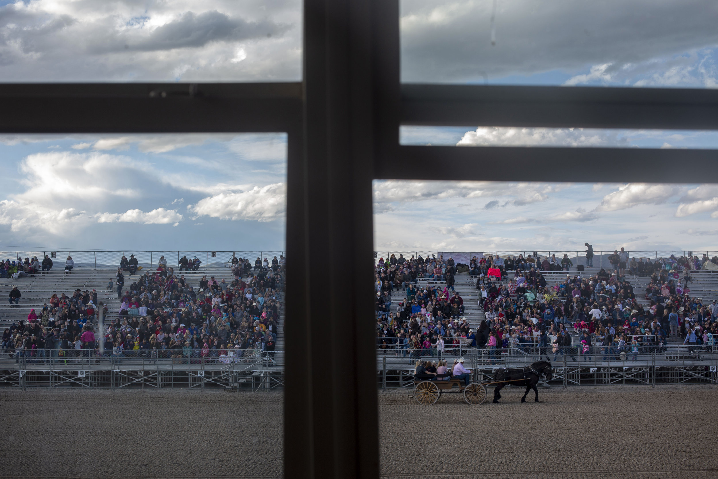 A horse and carriage passes through the arena at the Pony Express Rodeo Saturday, May 25, 2019 at Eagle Mountain, Utah.